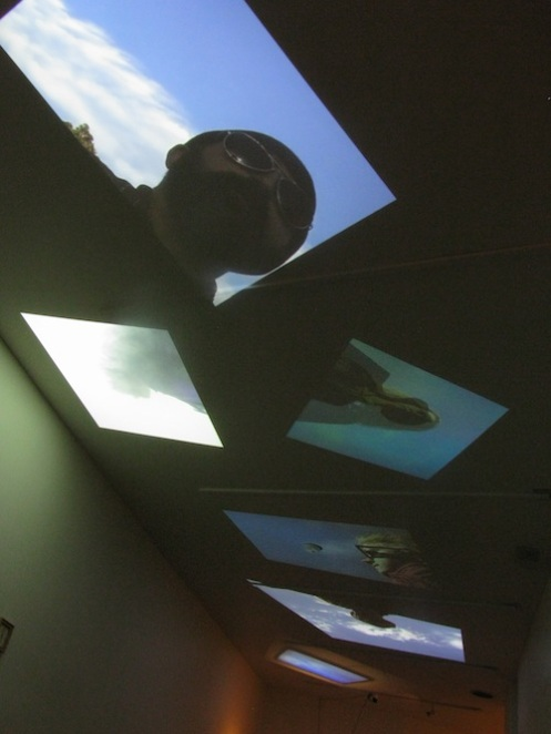 ^ video projections of people daydreaming/with their heads in the clouds.